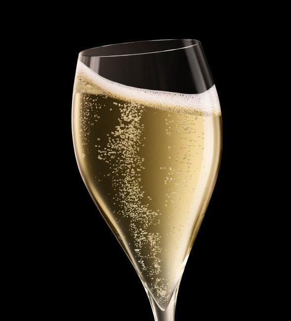 Sparkling wine bubbles in champagne glass